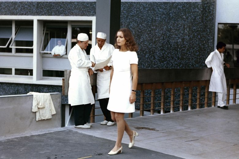 Romy Schneider Helene in film les choses de la vie 1970 walking out of the hospital after knowing Pierre´s death wearing André Courrèges white short sleeve dress walking out of hospital