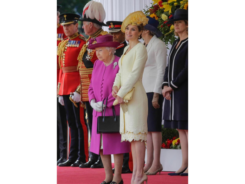 Letizia in a yellow suit by designer Felipe Varela, £550 Prada stilettos and a bespoke hat by Maria Nieto, Buckingham Palace