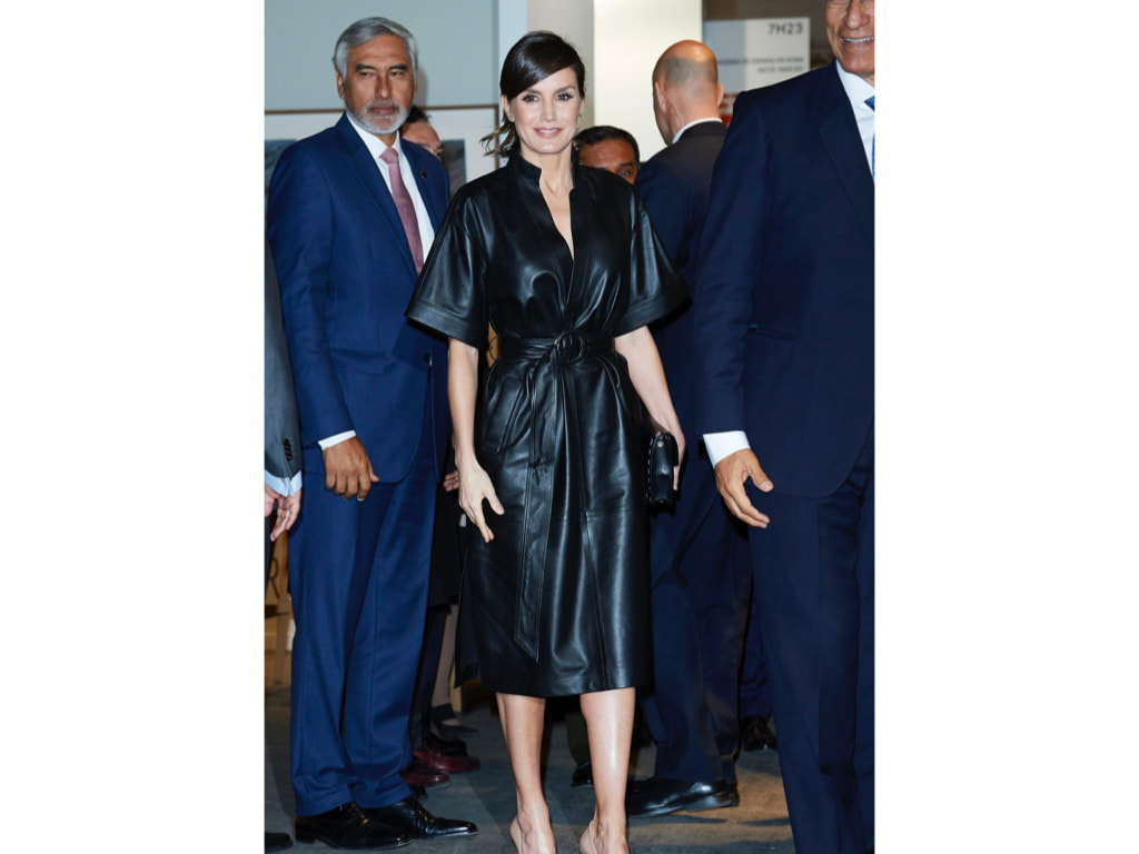 Letizia in & Other Stories mid-length dress ($421), featuring a belted waist, v-neck and kimono sleeves, a pair of nude Prada pumps, a studded clutch and studded earrings.