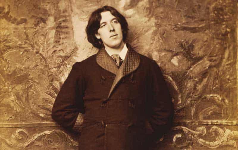 The most elegant intellectual man Oscar Wilde Wilde reclining with Poems, by Napoleon Sarony in New York in 1882.