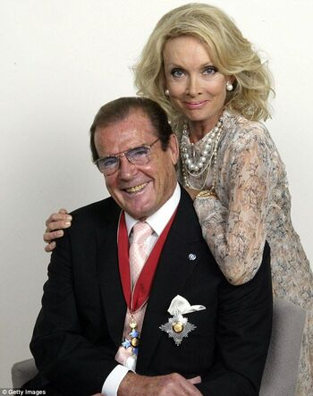 Roger Moore with his fourth wife Kristina