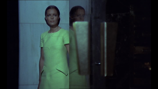 Romy Schneider Helene in film les choses de la vie 1970 wearing andre courreges green short sleeve dress standing beside the gate of her home