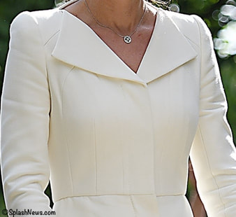 Kate Middleton Duchess of Cambridge bespoke wing lapel wool silk coat dress by Alexander McQueen Charlotte Christening 2015 detail