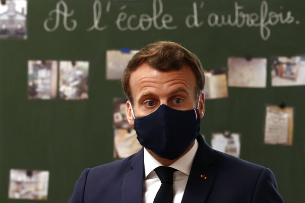 French president Emmanuel Macron wears dark bule cloth mask made by French president Emmanuel Macron wears dark bule cloth mask made by Chanteclair in France that complments with his suit