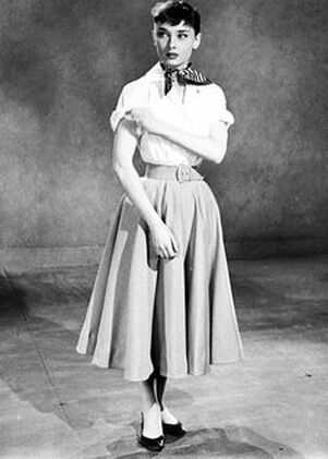 All about Audrey Hepburn movie costume ensemble of white shirt and ankle circle skirt in film Roman Holiday, 1953