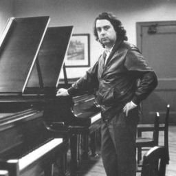 French composer Philippe Sarde standing in front of a piano as a young man