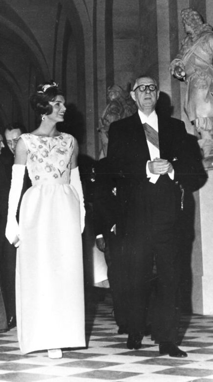 Jackie Kennedy in ivory satin dress designed by French coutourier Hubert de Givenchy, with general de Gaulle in Versailles 1961
