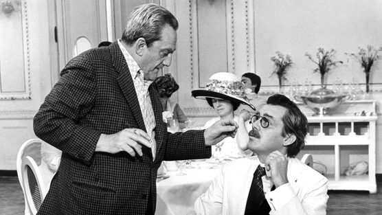 Luchino Visconti with British actor Dirk Bogarde while filming Death in Venice.