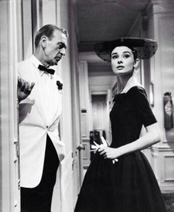 Audrey Hepburn's little black dresses in film Love in the afternoon, 1957