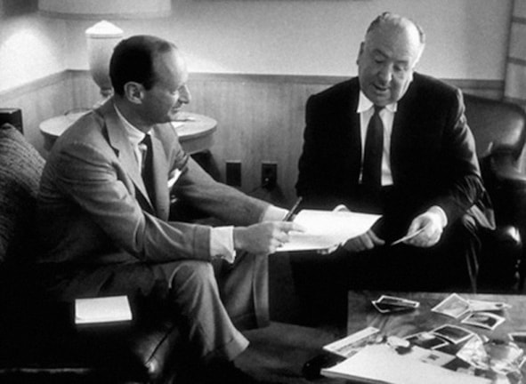 Screenwriter Ernest Lehman and director Alfred Hitchcock working on 'North by Northwest'