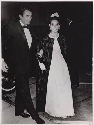 Gregory Peck with his second wife Véronique Passani (1932-2012), wearing Givenchy gown, 1965, New York