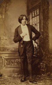 The most elegant writer Oscar Wilde wearing double breast suit
