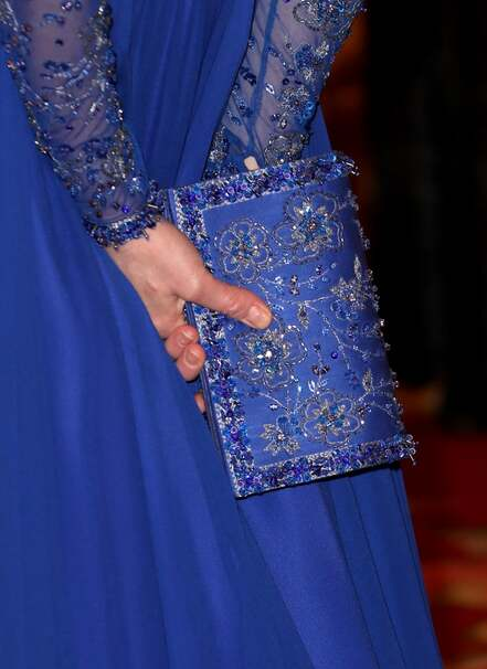 Kate Middleton in royal blue Jenny Packham gown with matching beaded clutch