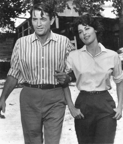 Gregory Peck with Ava Gardner, his co-star for three films and friend, filming On the Beach(1959)