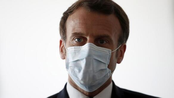 Emmanuel Macron wearing surgical mask