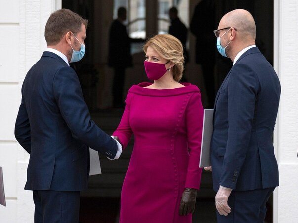 Slovakian President Zuzana Caputova wears a crushed raspberry pink mask that matches her outfit outside the presidential palace in Bratislava.