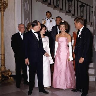 Jackie Kennedy (in Guy Dovier designed pink silk Shantung strapless gown) with John. F. Kennedy at White House, Washington, receiving Andre Malraux, The French Minister of Culture, 11 May 1962
