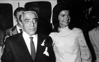 Jackie Kennedy Onassis on her wedding day with Aristotle Onassis in white wedding dress designed by Valentino Garavani