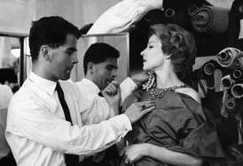 Karl Lagerfeld fitting with model when he worked for Jean Patou, on 21 July 1958