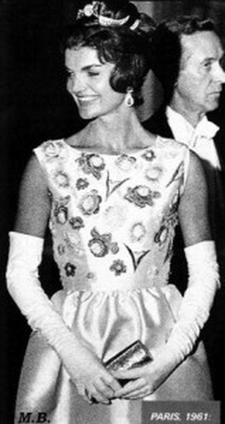Jackie Kennedy wearing ivory Silk ziberline evening gown designed by Hubert de Givenchy for the state visit dinner in Versailles France, 1 June 1961