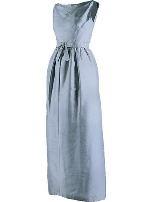 Pale blue sleeveless silk shantung eveningi dress Jackie Kennedy wore for dinner hosted by Queen Elizabeth II on her state visit to England, Buckingham Palace London, 5 June 1961, designed by Chez Ninon, featuring decorative bow on belt and soft pleats on skirt