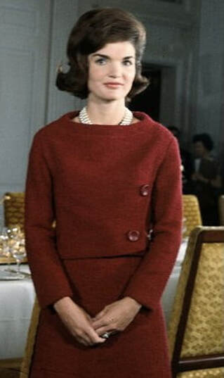 Jackie Kennedy wearing red 2 piece day dress for the CBS televised program: A tour of the White House with Mrs. John F. Kennedy, Washington DC, 14 February 1962