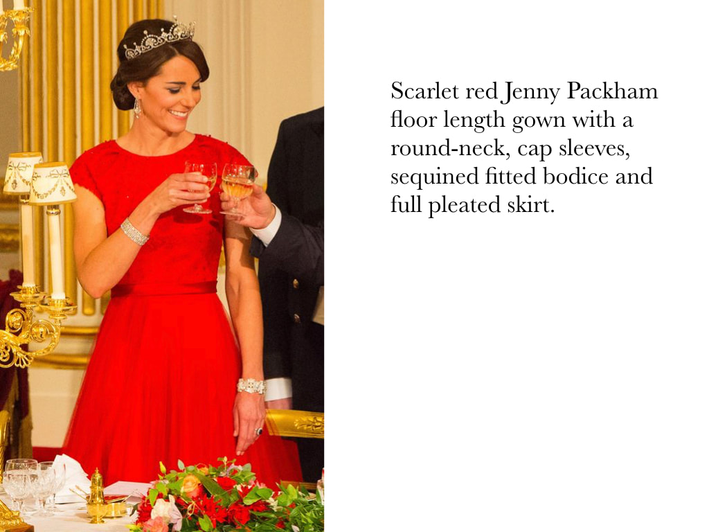 Kate Middleton Duchess of Cambridge in Scarlet red Jenny Packham floor length gown with a round-neck, cap sleeves, sequined fitted bodice and full pleated skirt.